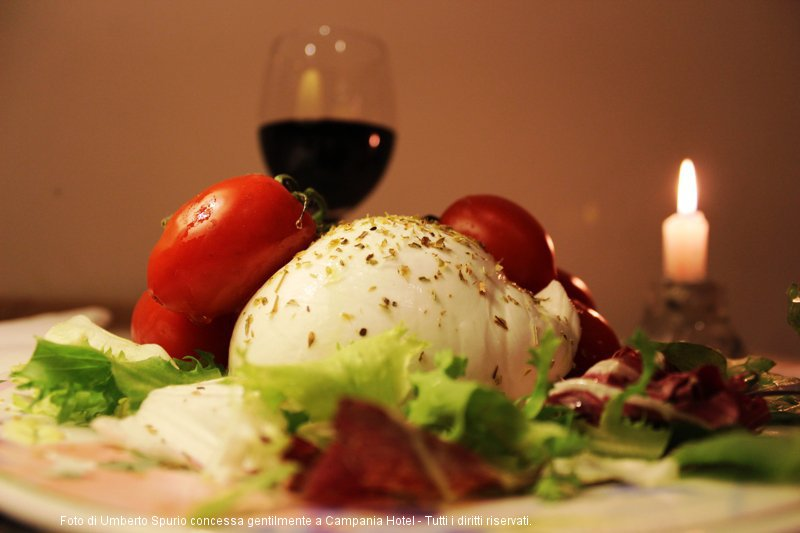 Buffalo Mozzarella with Pachino baby tomatoes on a bed of mixed salad